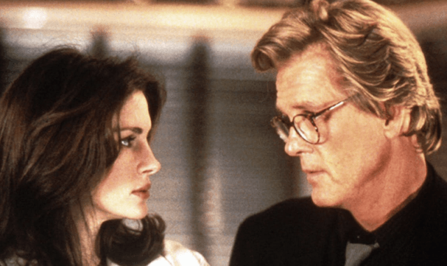 Julia Roberts and Nick Nolte look at each other as they stand closely.