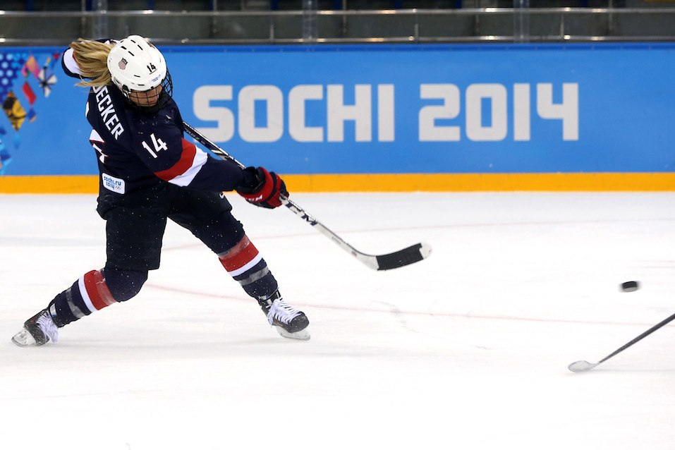 Brianna Decker #14 of the United States shoots and scores in the third period against Sweden