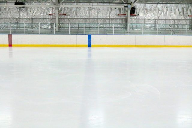An empty ice skating rink.