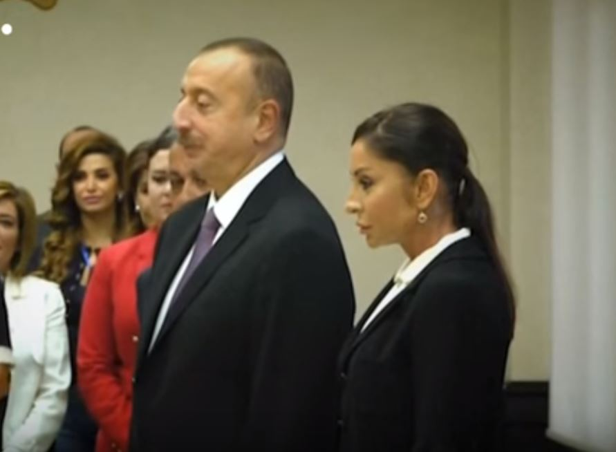 The President of Azerbaijan, Ilham Aliyev, and his wife pause before voting in an election