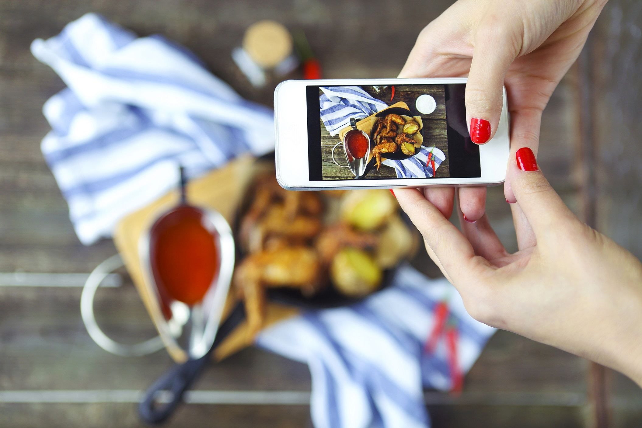 Woman taking photo of food for instagram