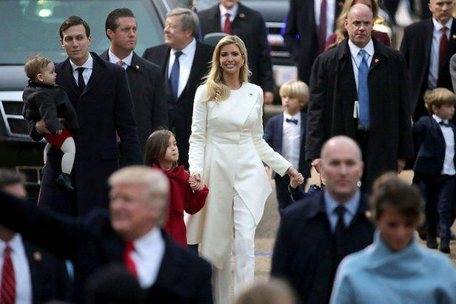 Ivanka and Jared walking with their children.