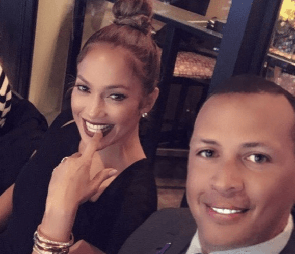 Jennifer Lopez and Alex Rodriguez smiling together.