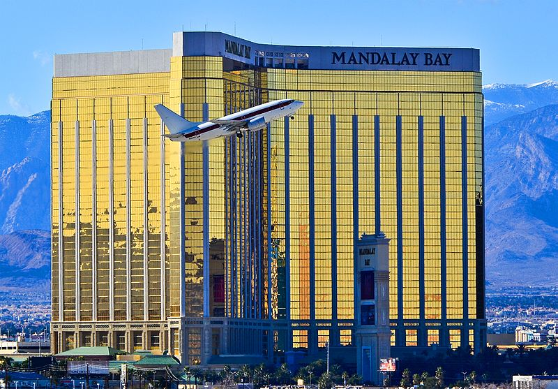 JANET airplane flying in front of Mandalay Bay hotel