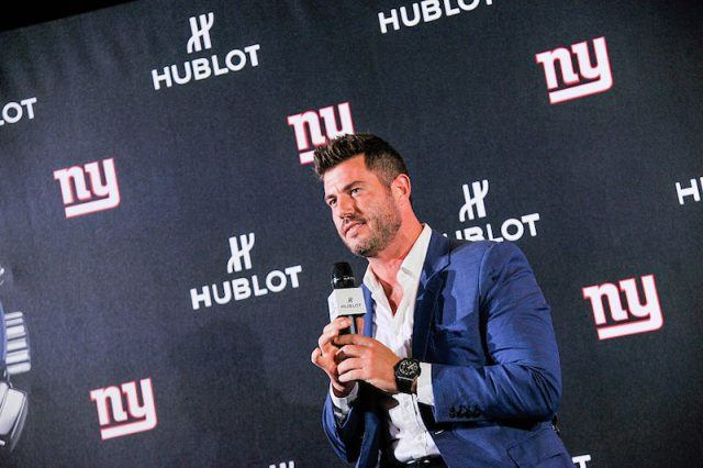 Jesse Palmer sitting and speaking into a microphone.