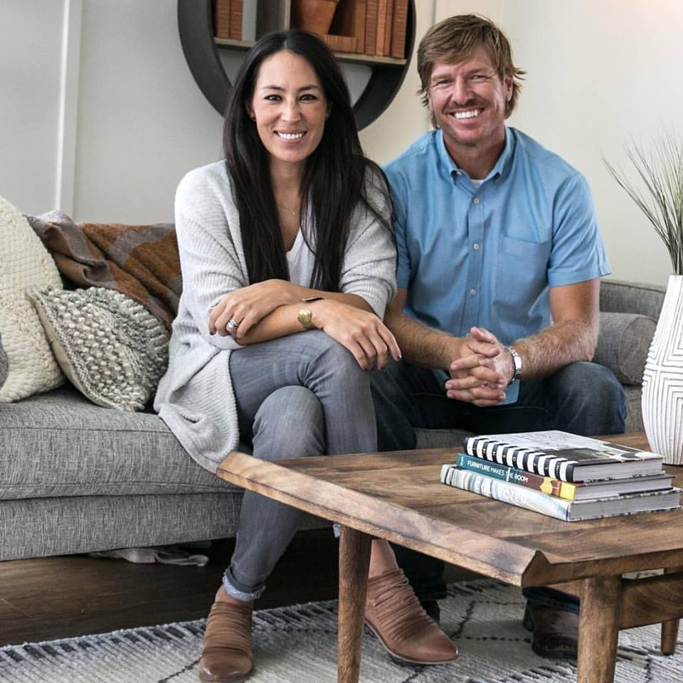 Joanna and Chip Gaines sitting on couch