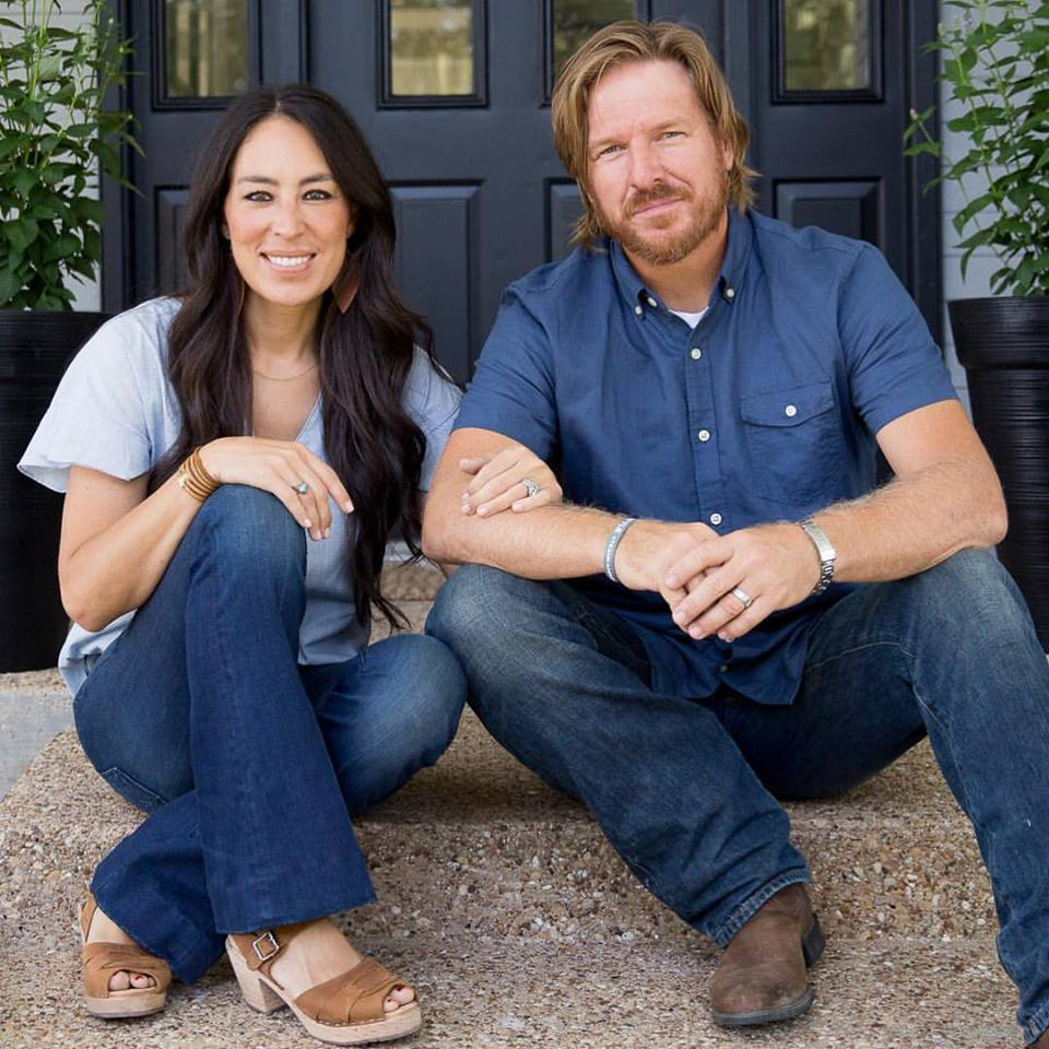 Joanna and Chip Gaines sitting on front step