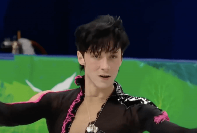 Johnny Weir skating on ice.