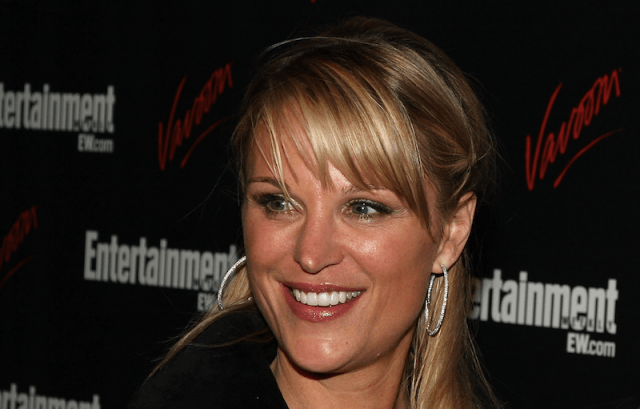 Juliet Huddy smiling on a red carpet.
