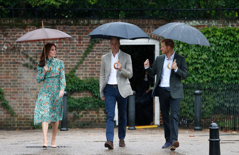 Catherine, Duchess of Cambridge, Prince William, Duke of Cambridge and Prince Harry are seen during a visit to The Sunken Garden at Kensington Palace