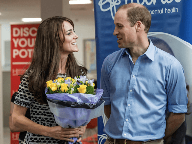 Kate Middleton and Prince William smiling at each other.