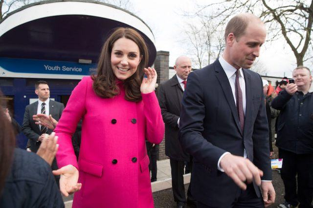 Kate Middleton and Prince William greeting the public during a trip.