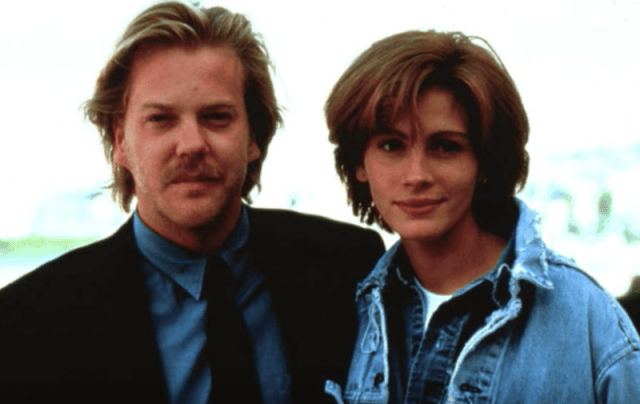 Julia Roberts and Keifer Sutherland posing together.