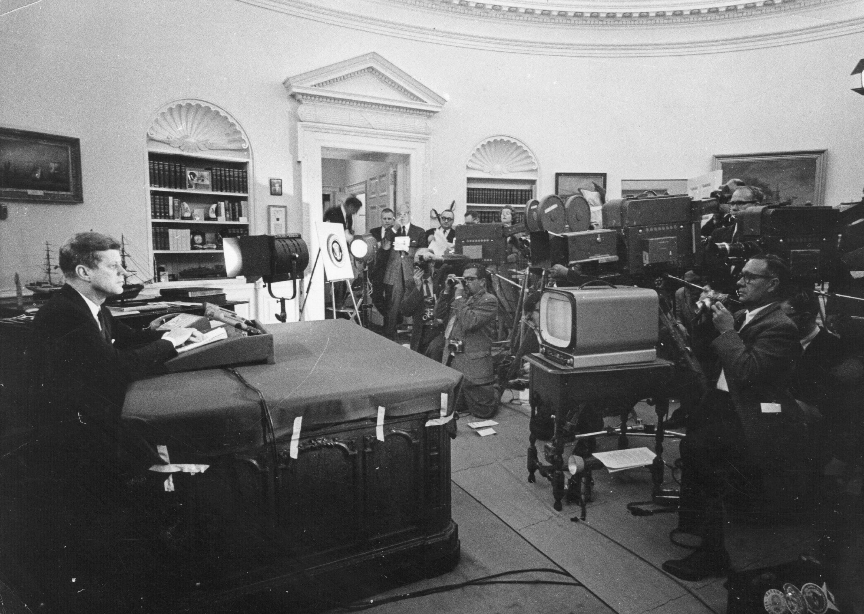 John F. Kennedy In the oval office with TV Cameras