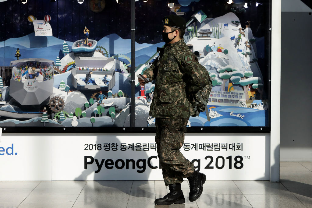 A South Korean soldier walks past the 2018 PyeongChang Winter Olympic and Paralympic Games