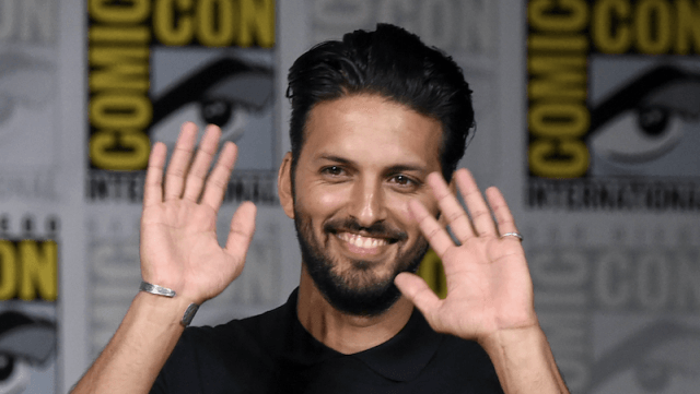 Latif waves at fans while attending a Comic-Con panel.