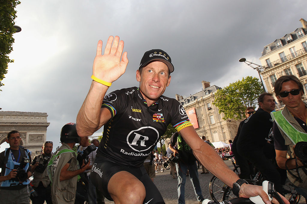 Lance Armstrong of team Radioshack waves to fans after the twentieth and final stage of Le Tour de France