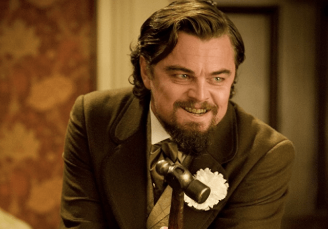 Leonardo DiCaprio holds a hammer and laughs in 'Django Unchained'.
