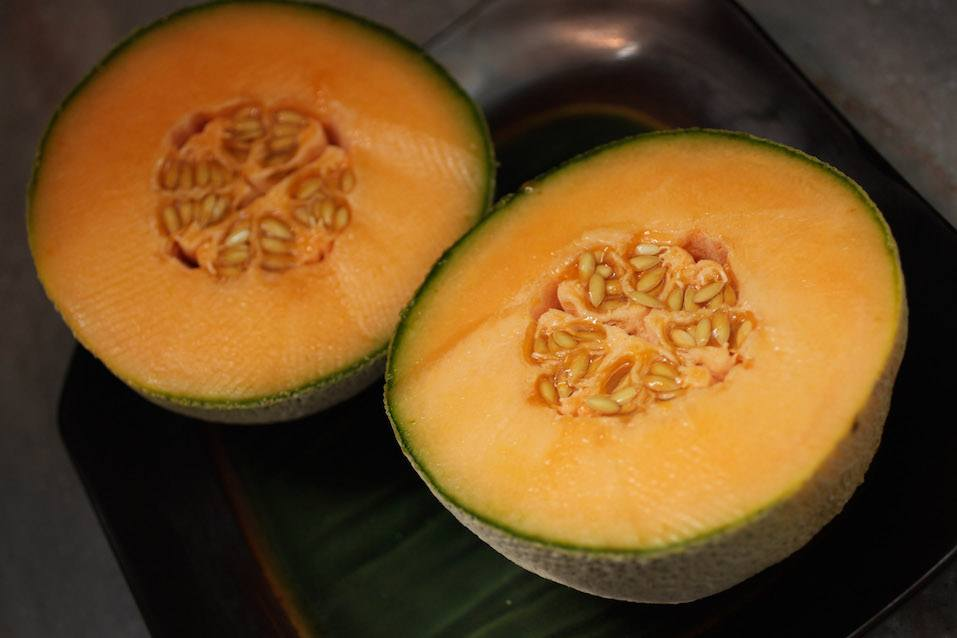 Cantaloupe is seen sliced open