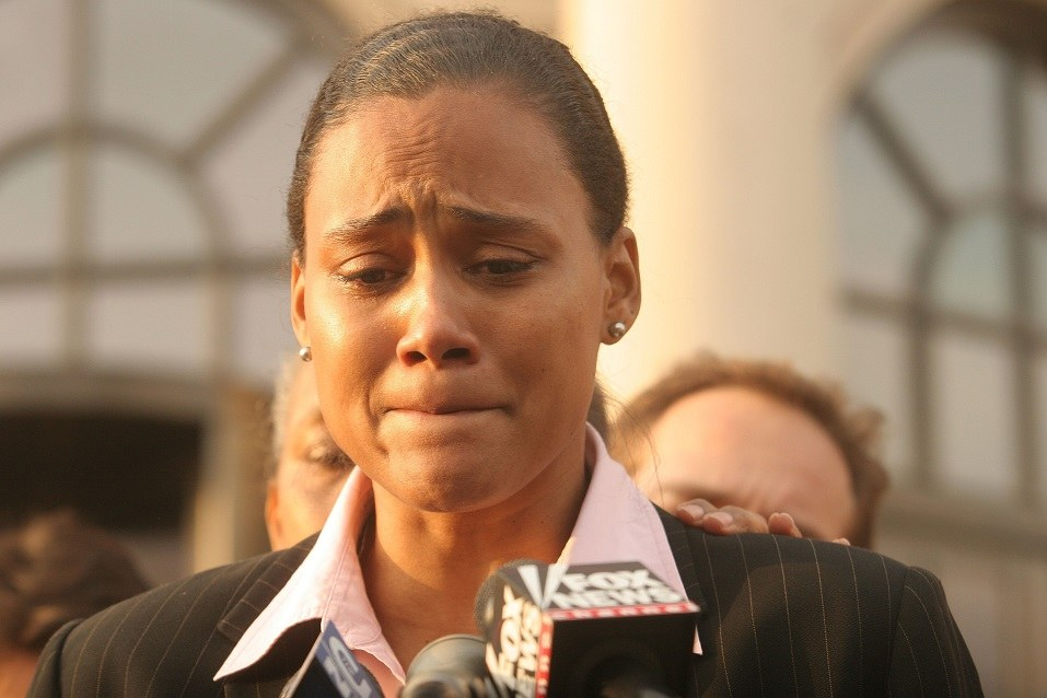 Three-time Olympic gold medalist Marion Jones speaks to the media outside a United States federal courthouse