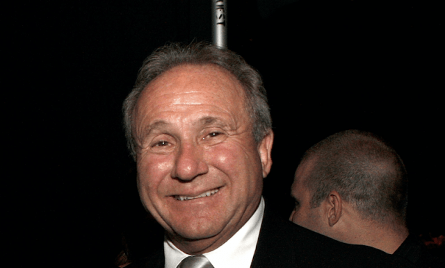Michael Reagan smiling in a black suit.