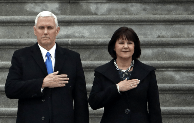Mike Pence and Karen Pence standing with their right hands over their hearts.