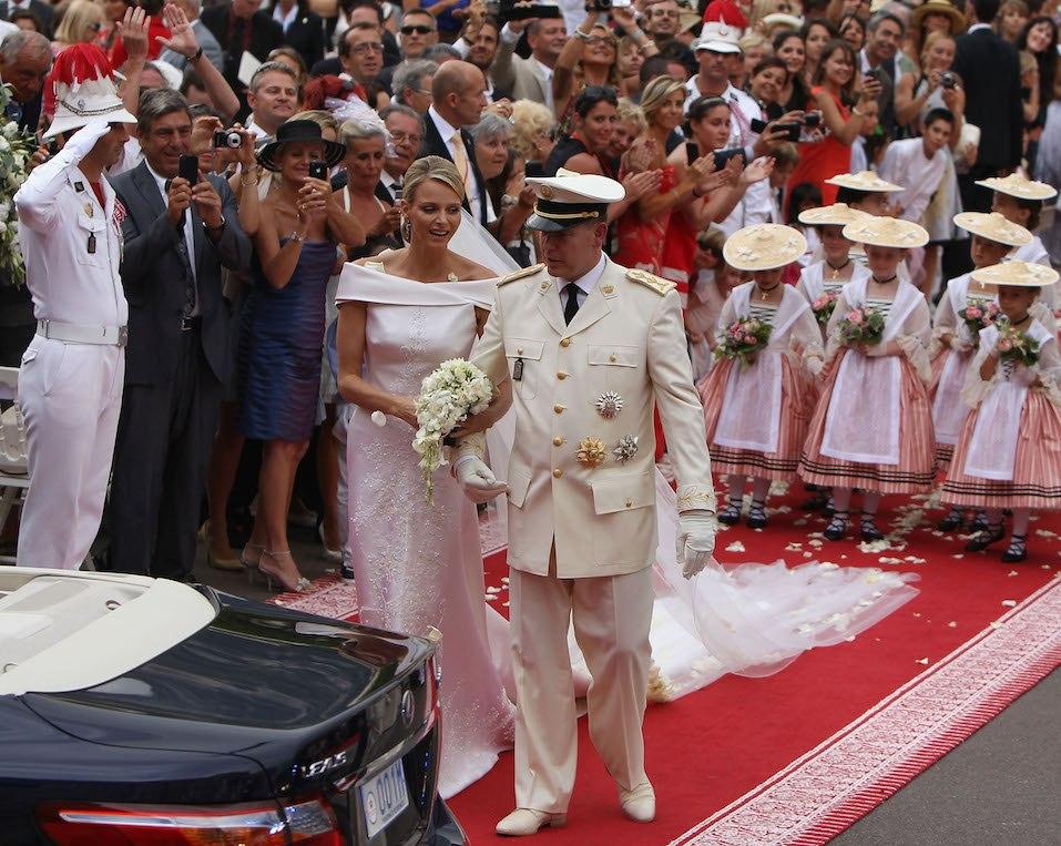Princess Charlene of Monaco and Prince Albert II of Monaco make their journey to Sainte Devote church