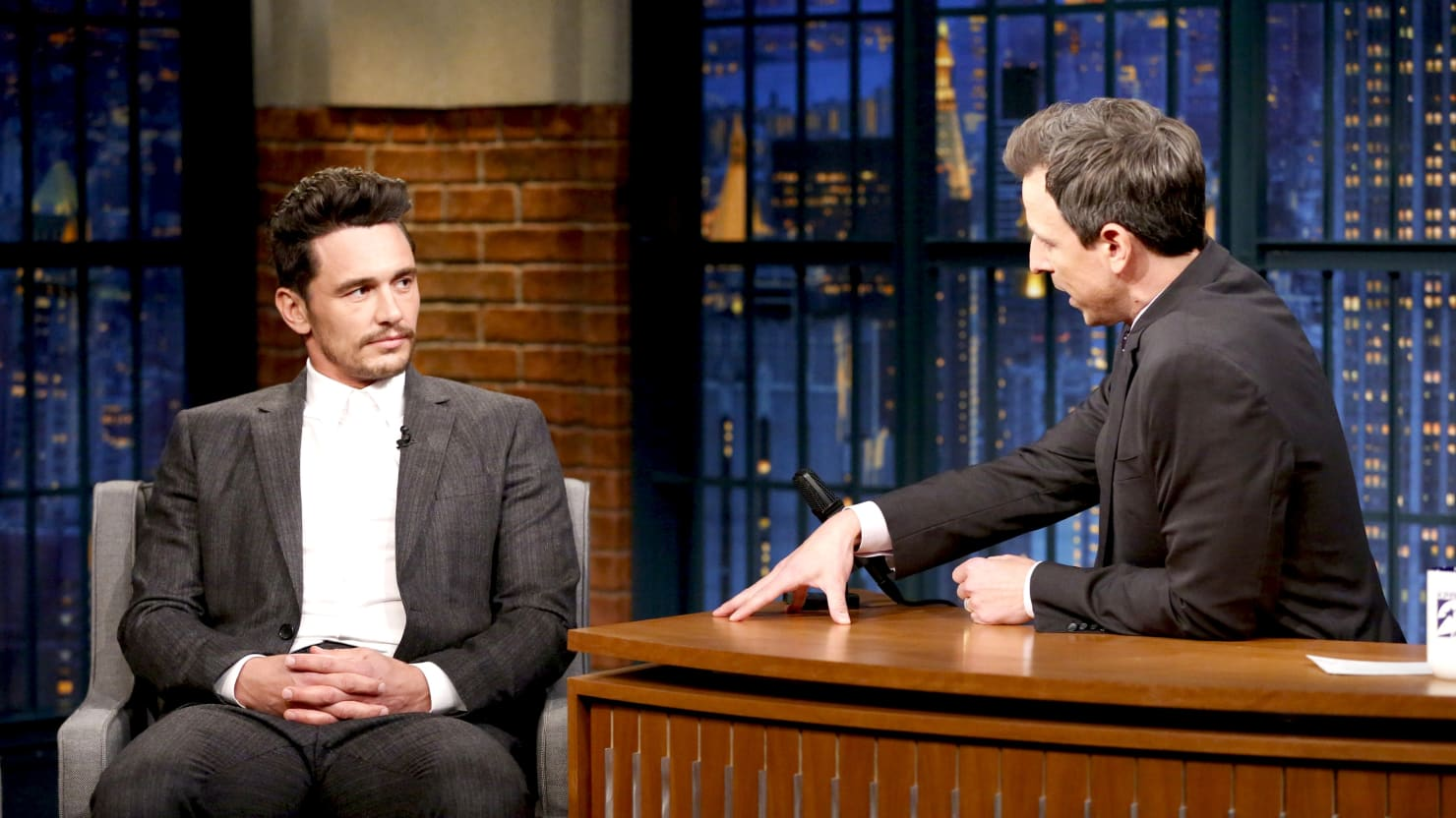 James Franco sits across from Seth Meyers