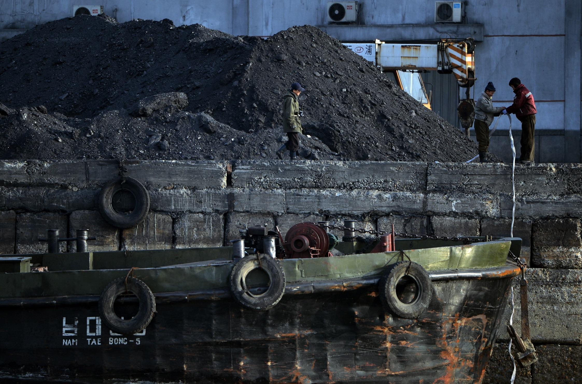 North Korean laborers near ship