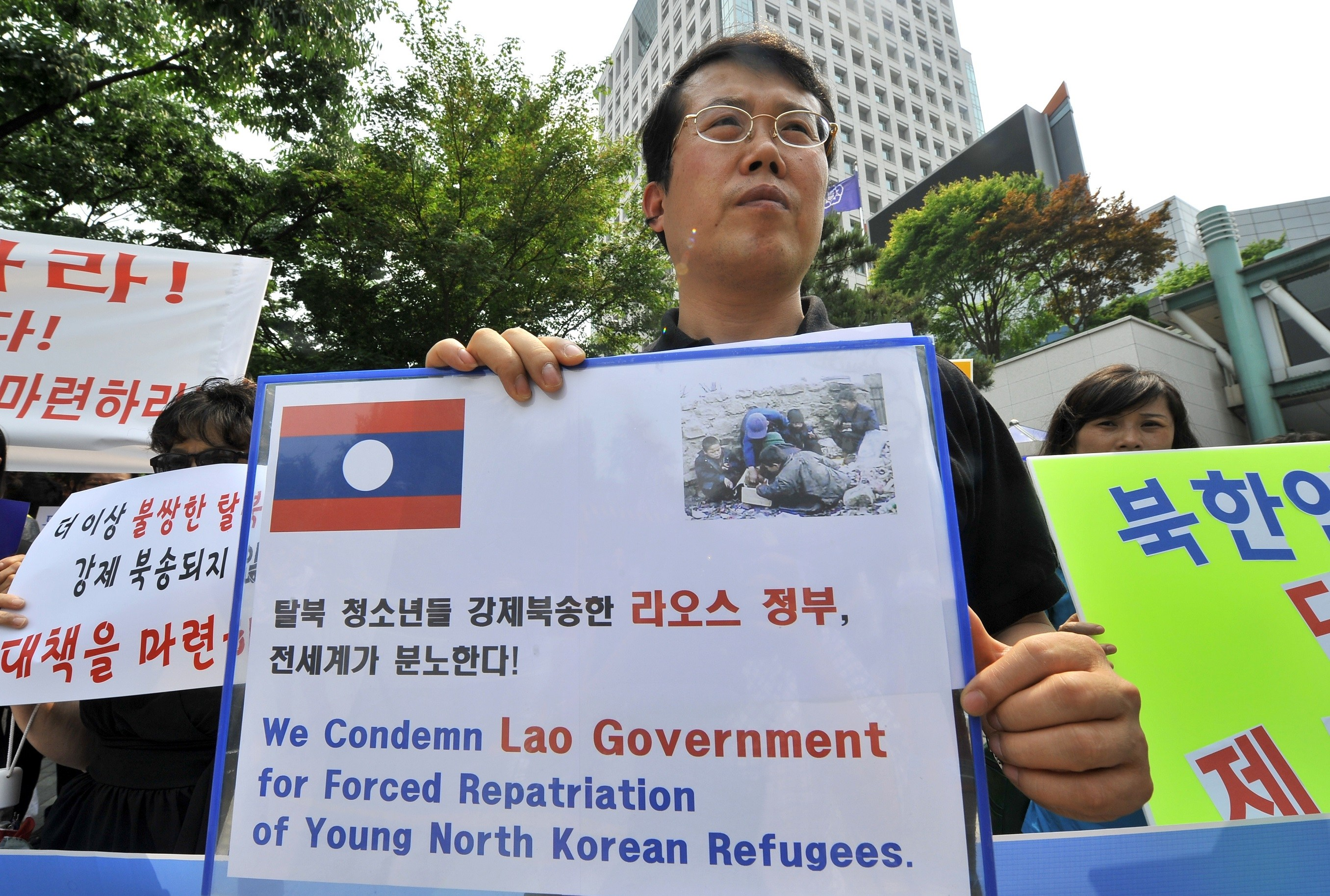 North Korea Defector protesting with sign