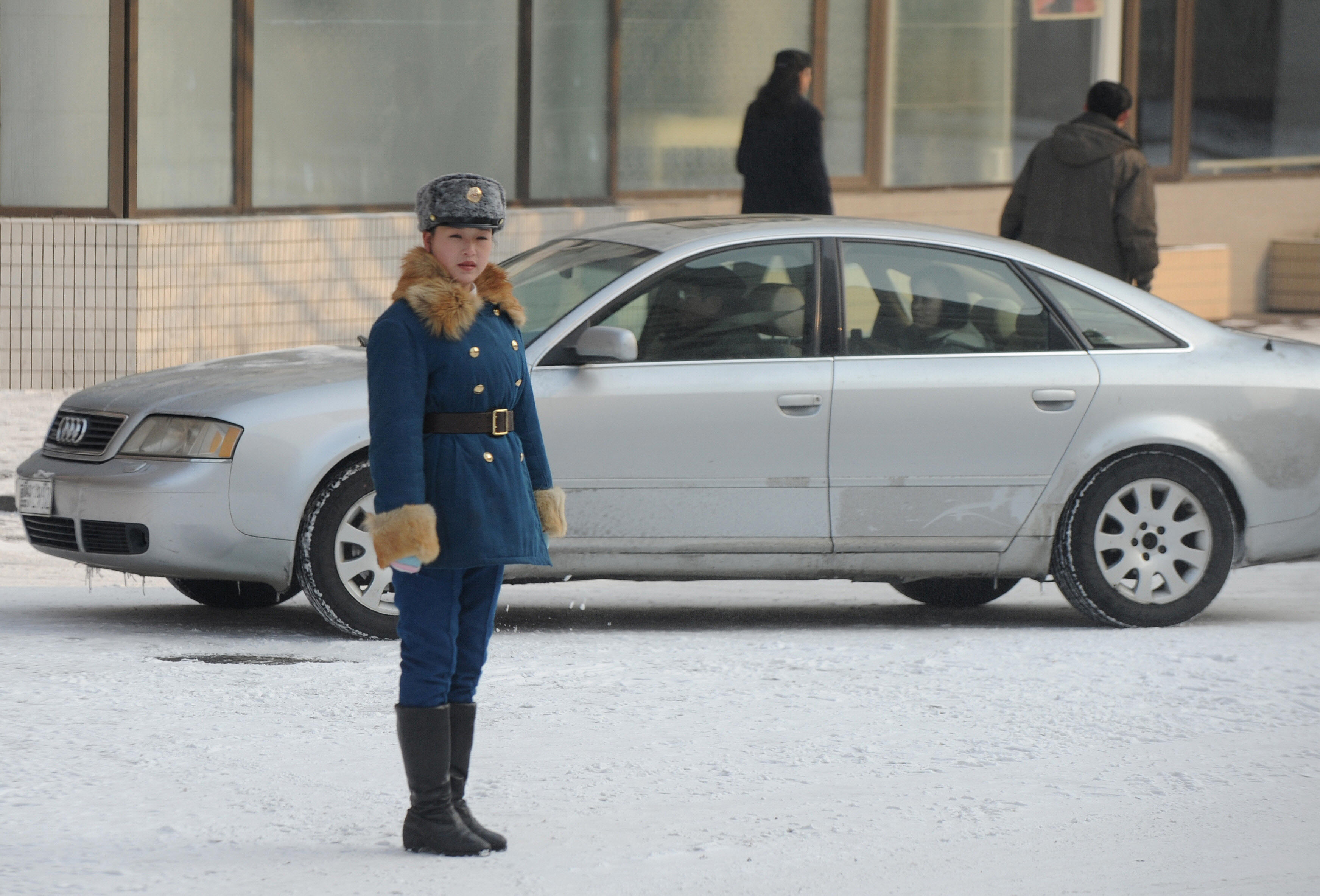 A North Korean traffic policewoman, dire