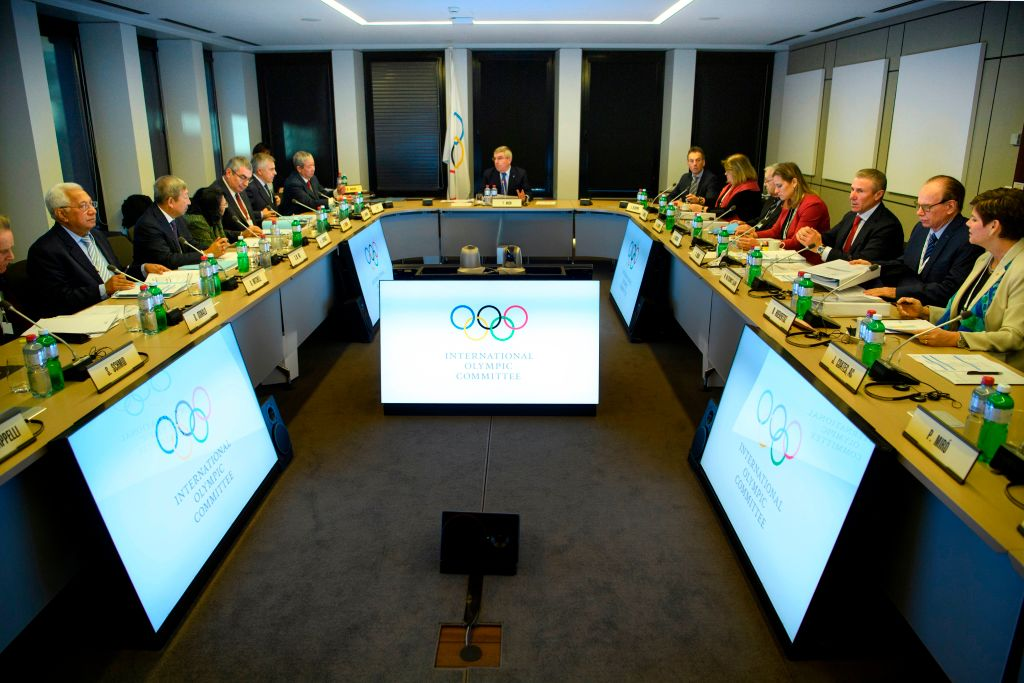 International Olympic Committee executive board members listen to president Thomas Bach from Germany