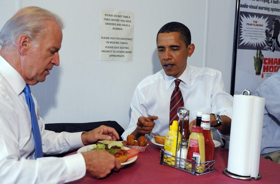 U.S. President Barack Obama and Vice President Joe Biden receive their cheeseburger lunch orders