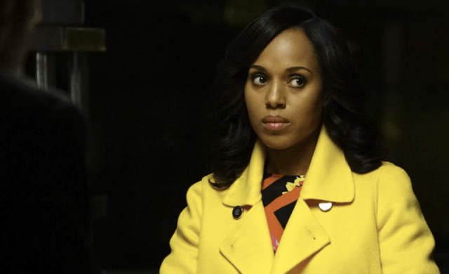 Olivia Pope looking serious while wearing a yellow coat.