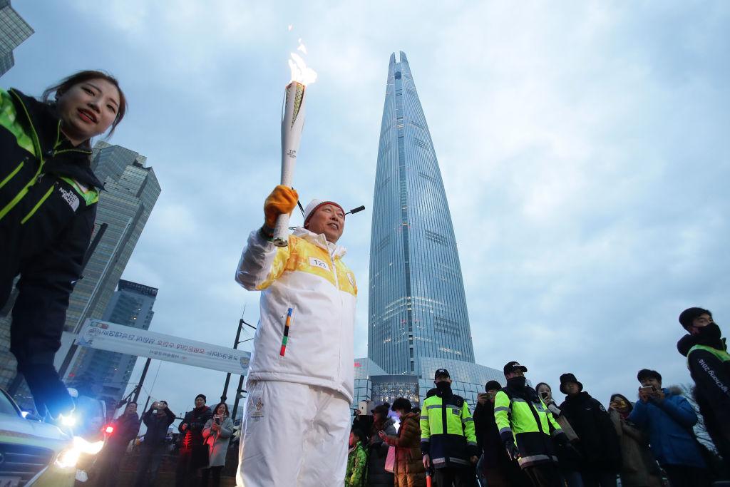 Shin Dong-bin, chairman of Lotte Group, holds the PyeongChang 2018 Winter Olympics torch