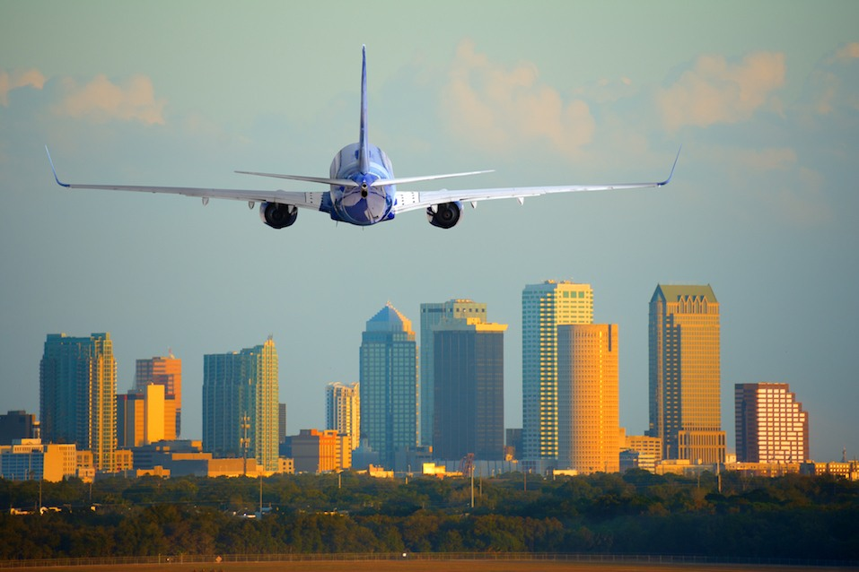 Tampa, Florida, skyline with warm sunset light with a commercial passenger jet airline