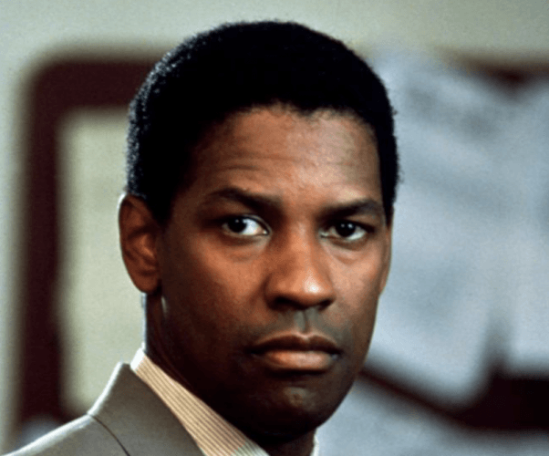 Denzel Washington looking serious and focused in 'Pelican Brief'.