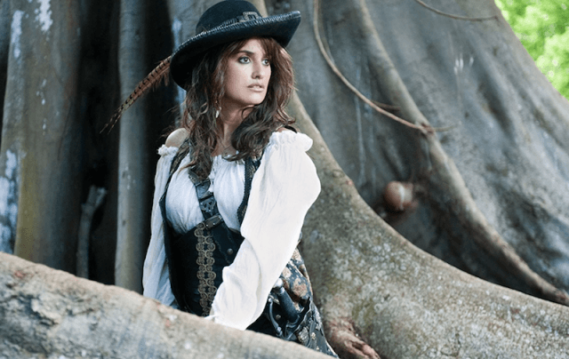 Penelope Cruz standing in front of a large tree in 'On Stranger Tides'.