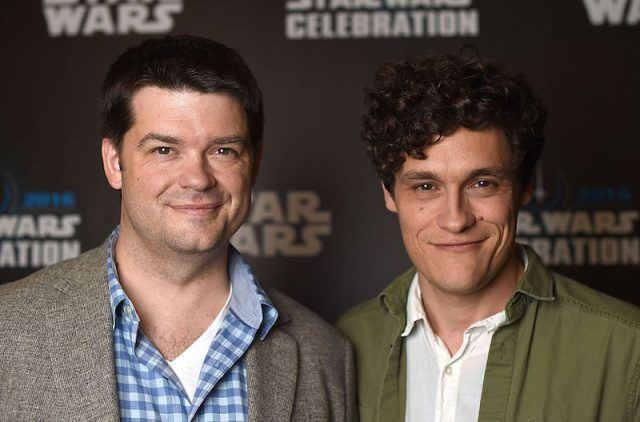 Chris Miller and Phil Lord posing together on a red carpet.