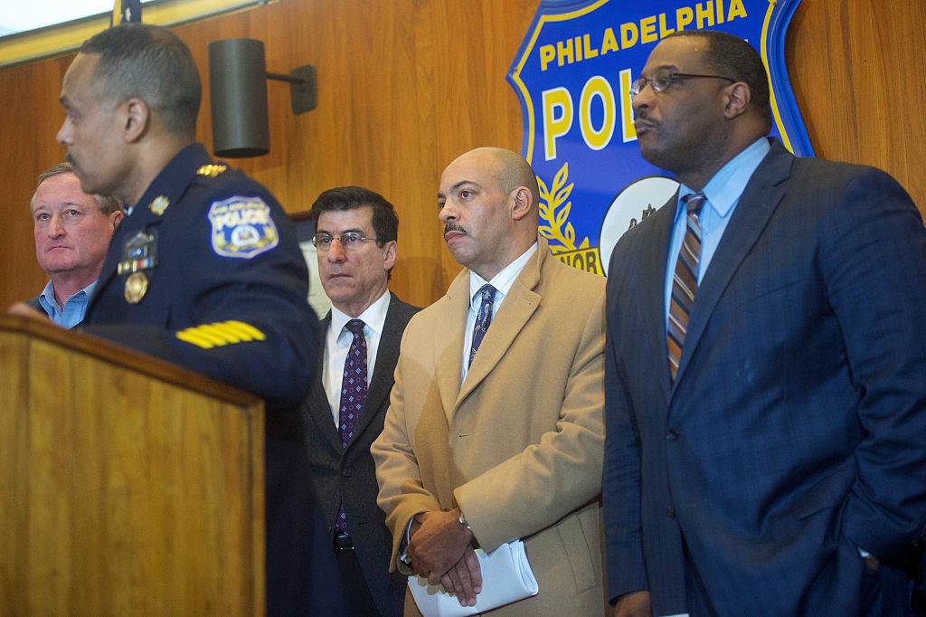 District Attorney of the city of Philadelphia Rufus Seth Williams listens to Philadelphia Police Commissioner Richard Ross