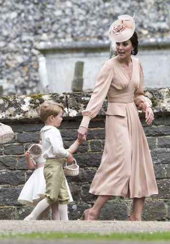 Kate Middleton holds her children at Pippa Middleton's wedding.