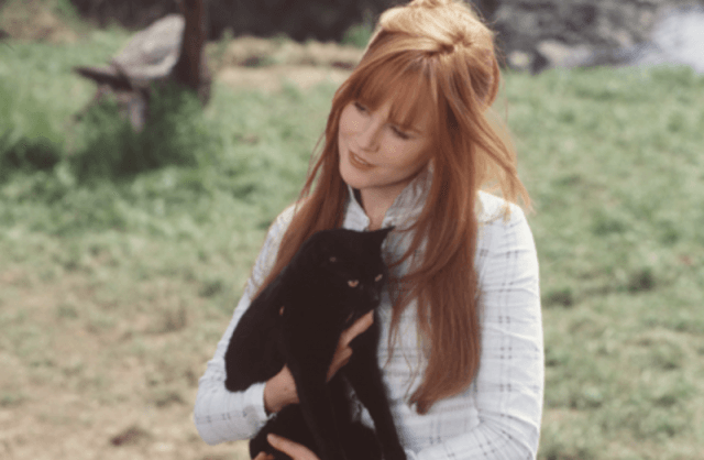 Gillian holding a black cat.