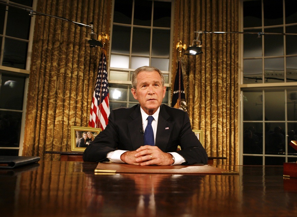 President George W. Bush poses for photographers