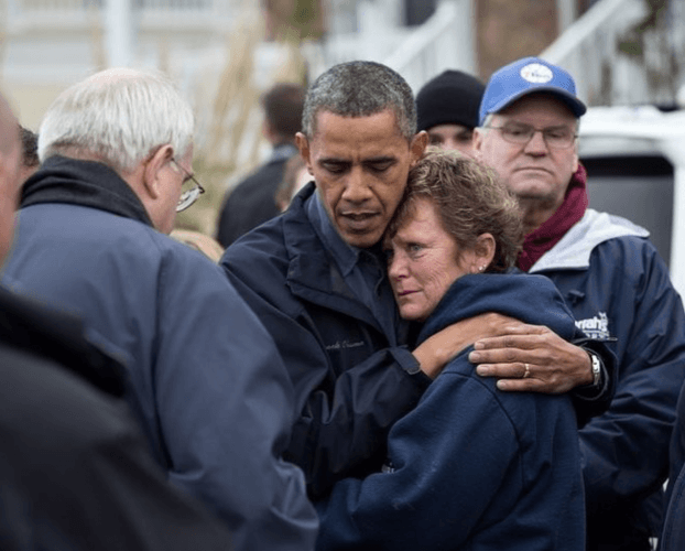 Barack Obama hugging a hurricane victim.