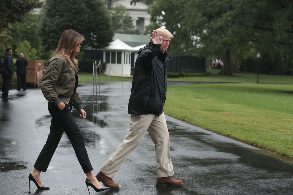 President Donald Trump walks with first lady Melania Trump prior to their Marine One departure