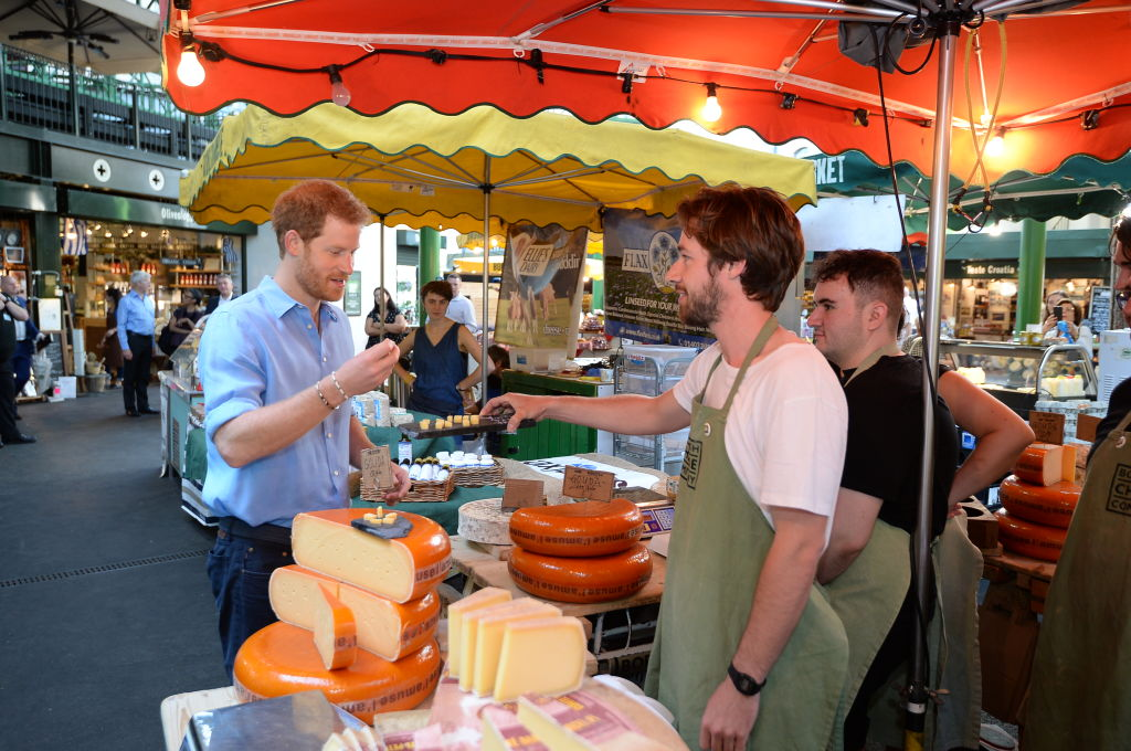 Prince Harry tours stalls during a visit to Borough Market which has opened yesterday for the first time