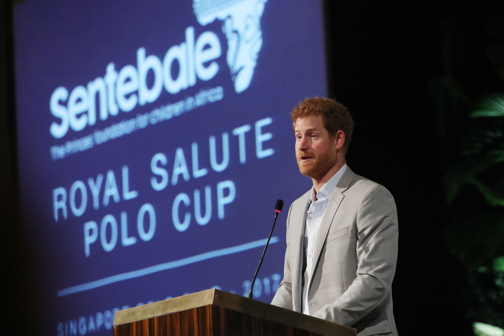 Prince Harry addresses guests at a dinner after the Sentebale Royal Salute Polo Cup