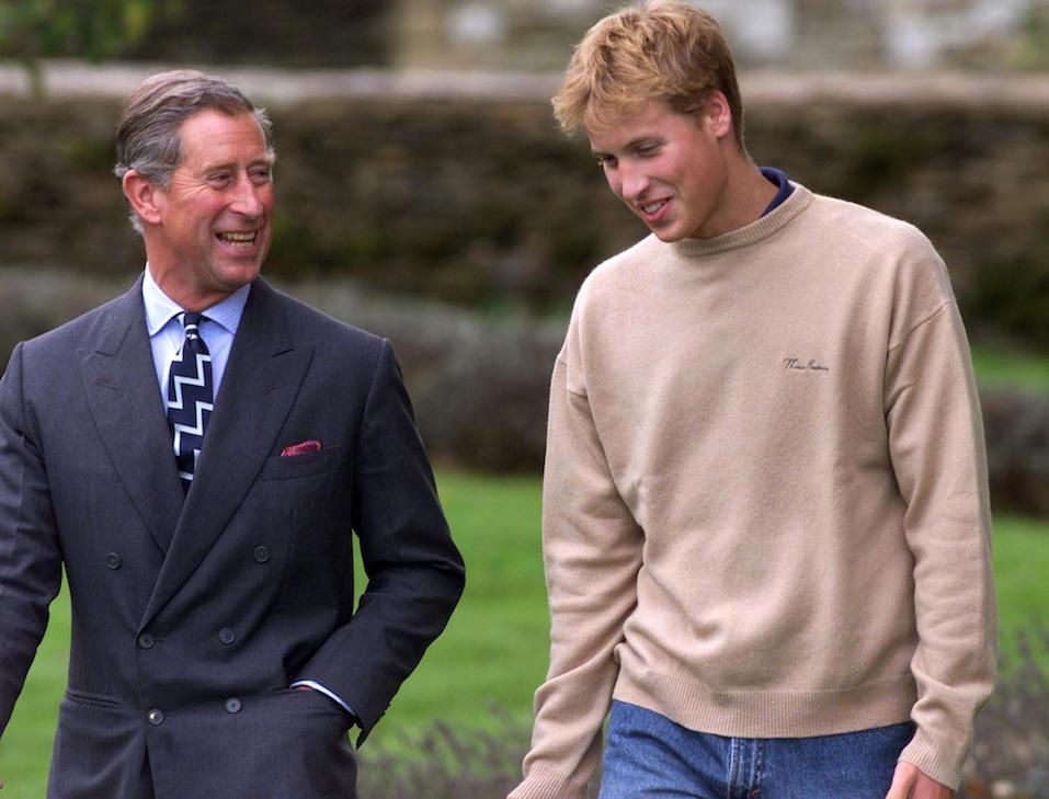 Prince William and his father Prince Charles walk through one of the gardens on the way to a photocall at Highgrove
