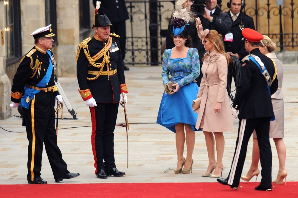 The Duke of York (L) arrives with his daughters Eugenie (3rd L) and Beatrice (3rd R) at the West Door of Westminster Abbey
