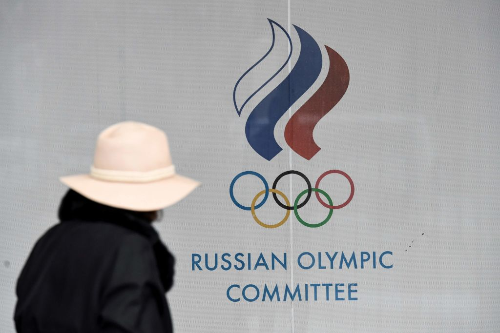 A woman walks in front of the Russian Olympic Committee building in Moscow